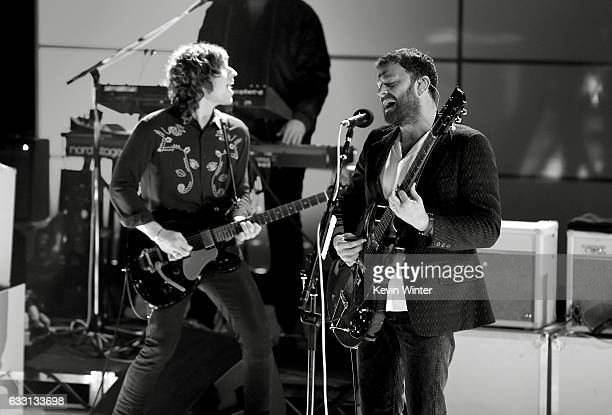 Matthew Followill and Caleb Followill of Kings Of Leon perform on stage on ATT at iHeartRadio Theater LA on January 30 2017 in Burbank California