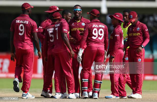 Matthew Forde of West Indies celebrates catching Daniel Mousley of England during the ICC U19 Cricket World Cup Group B match between England and...