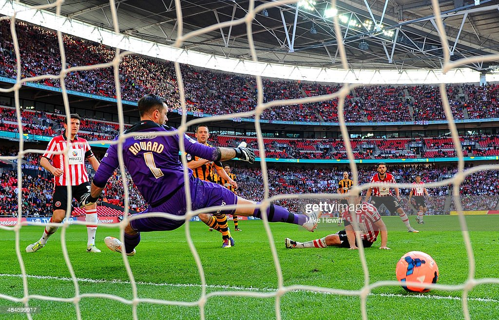 Matthew Fryatt of Hull City scores their second goal past Mark Howard of Sheffield United during the FA Cup with Budweiser semi-final match between Hull City and Sheffield United at Wembley Stadium on April 13, 2014 in London, England.