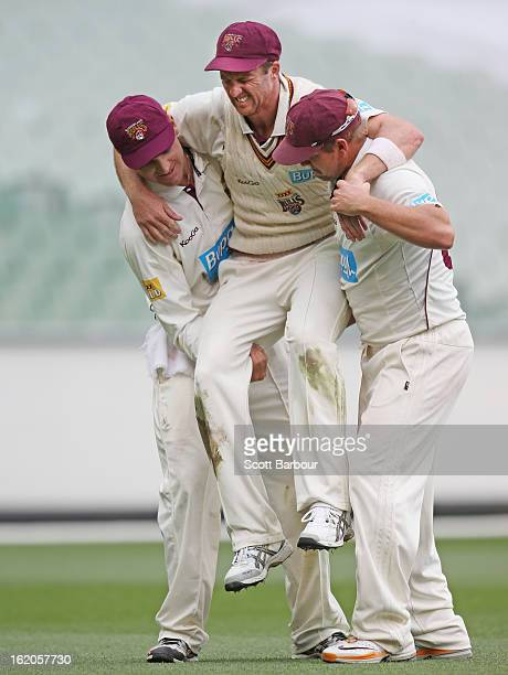 Matthew Gale of the Bulls is carried from the field by teammates James Hopes and Luke Pomersbach after injuring his knee while fielding during day...