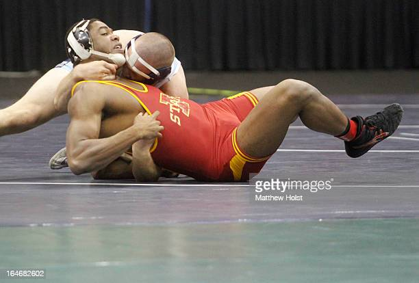 Matthew Gibson of the Iowa State Cyclones wrestles Odie Delaney of the Citadel Bulldogs in their heavyweight 7thplace match at the 2013 NCAA...