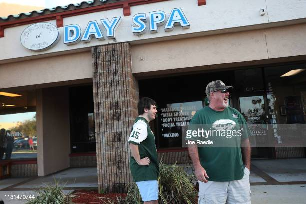 Matthew Gizze and Kevin Brown both of whom are NY Jet football fans stop to look at the Orchids of Asia Day Spa where New England Patriots owner...