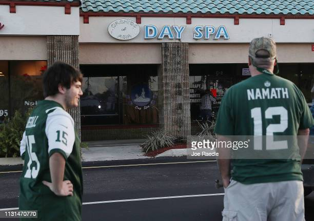 Matthew Gizze and Kevin Brown both of whom are NY Jets football fans stop to look at the Orchids of Asia Day Spa where New England Patriots owner...