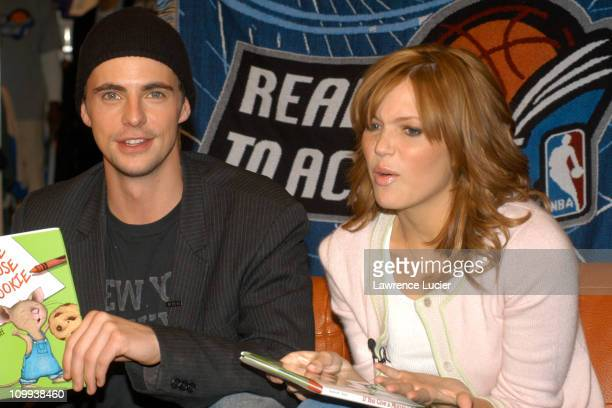Matthew Goode and Mandy Moore during Mandy Moore and Matthew Goode Participate in The NBA Read to Achieve Program at NBA Store in New York City New...