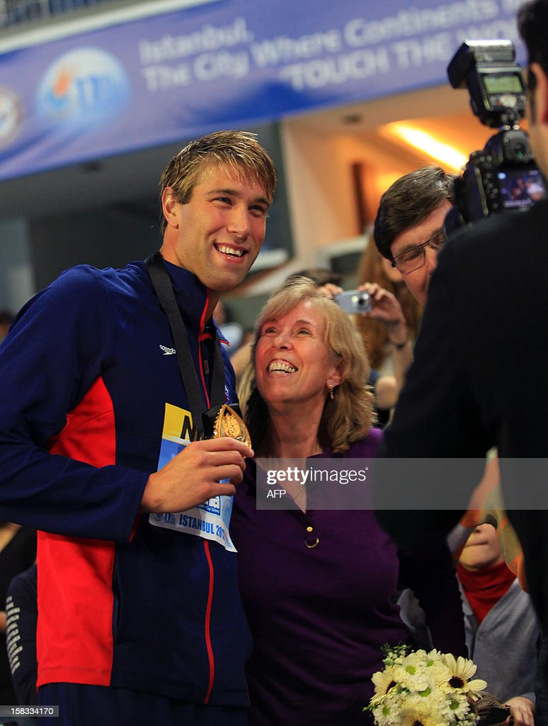 Matthew Grevers (L) of USA poses with his gold medal after winning the Men's 100m backstroke at the FINA World Short Course Swimming Championships at the Sinan Erdem Dome on December 13, 2012 in Istanbul.