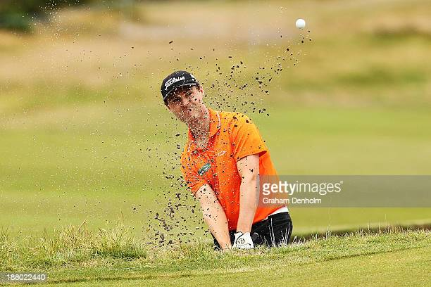 Matthew Griffin of Australia plays a shot out of the bunker during round two of the 2013 Australian Masters at Royal Melbourne Golf Course on...