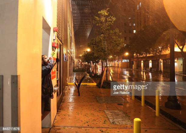 Matthew Hale looks out on the wind and rain as Hurricane Irma arrives in South Florida on September 10 2017 in Miami Florida Hurricane Irma made...
