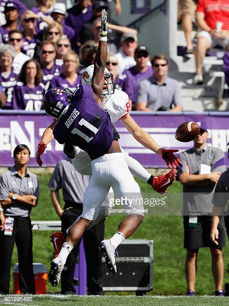 Matthew Harris of the Northwestern Wildcats is called for pass interference as he tries to break up a throw to Anthony Warrum of the Illinois State...