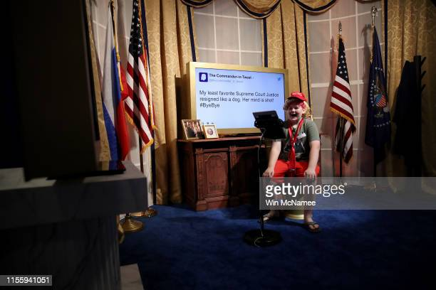 """Matthew Haskell takes a turn in an exhibit featuring the Oval Office during the opening of """"The Donald J Trump Presidential Twitter Library"""" June 14..."""