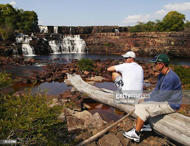Matthew Hayden and Justin Langer of Australia take in the sights at Orinduik Falls situated on the Guyana and Brazil border during a team trip to...