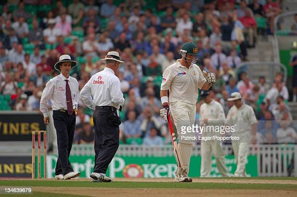 Matthew Hayden leaves the field after accepting the offer of bad light umpires are Bowden and Keortzen England v Australia 5th Test The Oval Sep 05