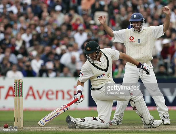 Matthew Hayden of Australia and Andrew Strauss of England look on as Hayden is almost bowled by Ashley Giles of England during day five of the Third...