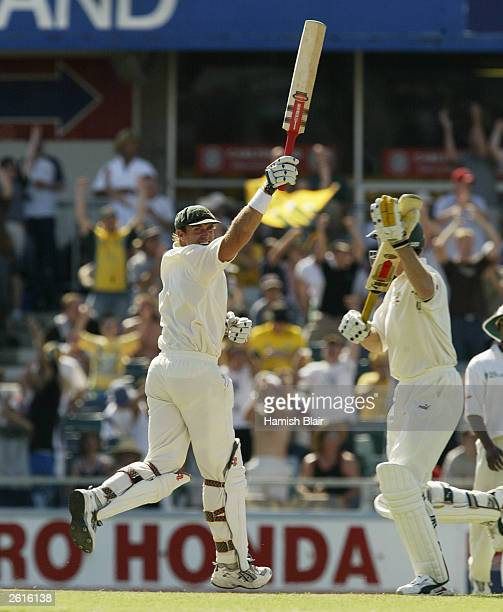 Matthew Hayden of Australia celebrates reaches 376 breaking Brian Lara of The West Indies world record of 375 during day two of the First Test...
