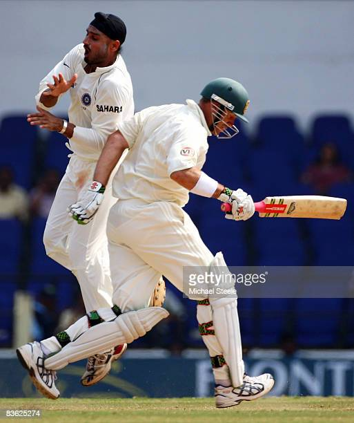Matthew Hayden of Australia collides with Harbhajan Singh of India as he runs down the wicket during day five of the Fourth Test match between India...