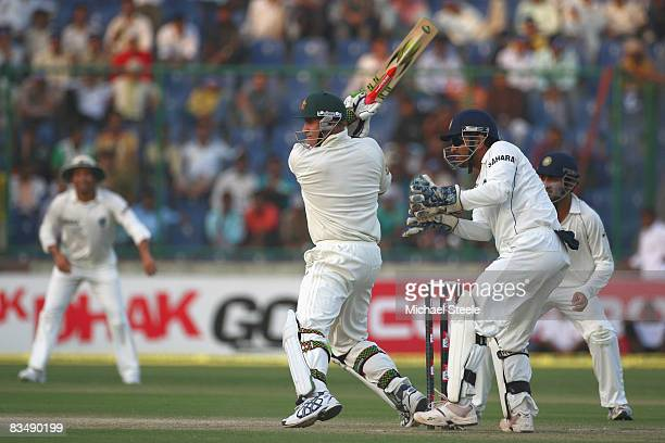 Matthew Hayden of Australia hits a four off the bowling of Amit Mishra of India during day two of the Third Test match between India and Australia at...