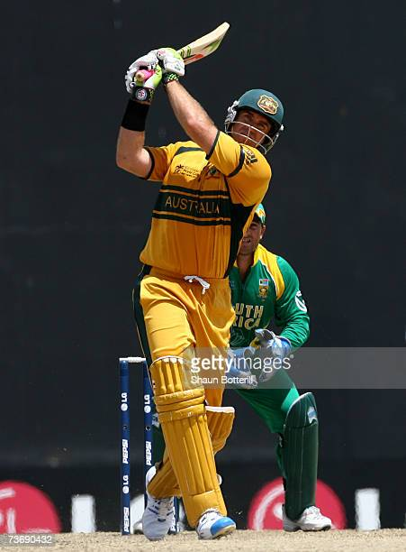 Matthew Hayden of Australia hits a six to score a century during the ICC Cricket World Cup 2007 Group A match between Australia and South Africa at...