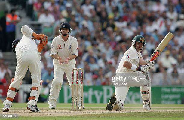 Matthew Hayden of Australia hits out as Ian Bell of England looks on during day three of the Fifth npower Ashes Test match between England and...