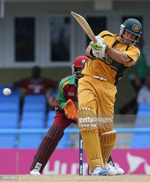 RCH 27 Matthew Hayden of Australia hits through mid wicket with Denesh Ramdin of the West Indies looking on during the ICC Cricket World Cup 2007...