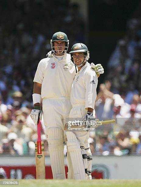 Matthew Hayden of Australia hugs team mate Justin Langer after hitting a six during day four of the fifth Ashes Test Match between Australia and...