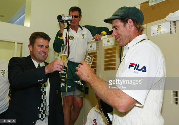 Matthew Hayden of Australia is congratulated by former Australian player Mark Taylor who held the previous Australian record score of 334 after...
