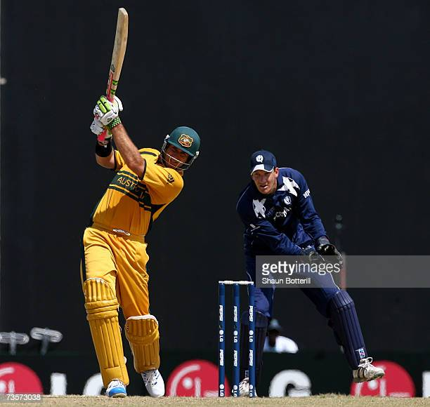 Matthew Hayden of Australia plays a shot as Colin Smith the Scotland wicketkeeper looks on during the ICC Cricket World Cup 2007 Group A match...