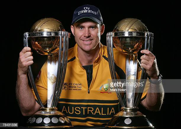 Matthew Hayden of Australia poses with the 1999 and 2003 World Cup trophies during the Australian Cricket team World Cup portrait session at The...