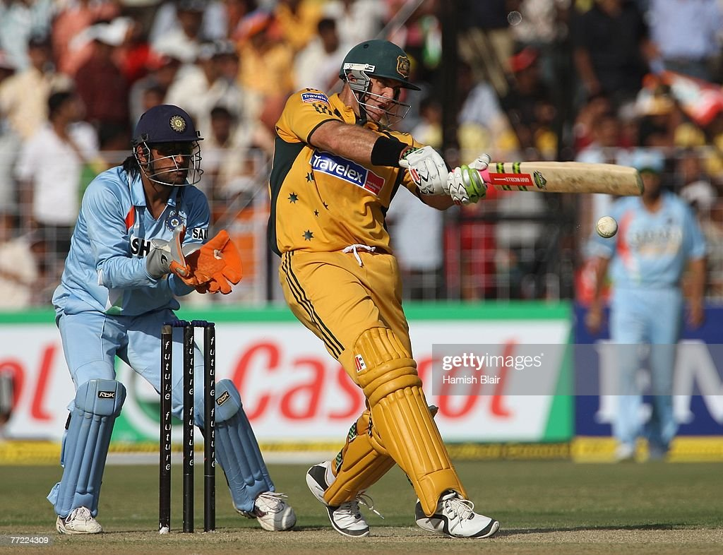 Matthew Hayden of Australia pulls with MS Dhoni of India looking on during the fourth one day international match between India and Australia at the..