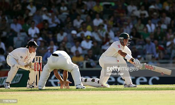 Matthew Hayden of Australia sweeps during day two of the third Ashes Test Match between Australia and England at the WACA on December 15 2006 in...