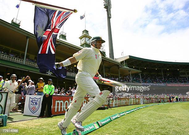 Matthew Hayden of Australia touches the Australian flag as he runs out to bat during day two of the fifth Ashes Test Match between Australia and...