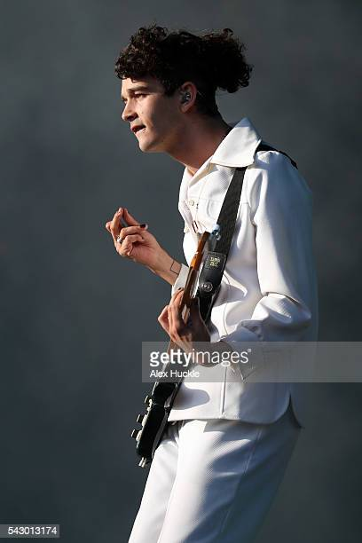 Matthew Healy of The 1975 performs on The Other Stage at the Glastonbury Festival at Worthy Farm Pilton on June 25 2016 in Glastonbury England