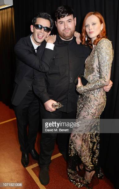 Matthew Healy Richard Quinn winner of the British Emerging Talent Womenswear award and Karen Elson pose backstage at The Fashion Awards 2018 in...