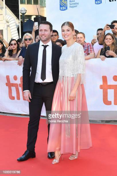 Matthew Heineman and Rosamund Pike attend the 'A Private War' premiere during 2018 Toronto International Film Festival at Roy Thomson Hall on...