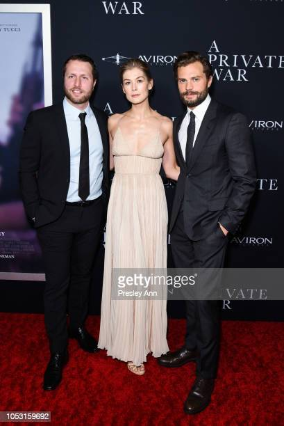 Matthew Heineman Rosamund Pike and Jamie Dornan attend Aviron Pictures' Los Angeles Premiere Of A Private War at Samuel Goldwyn Theater on October 24...