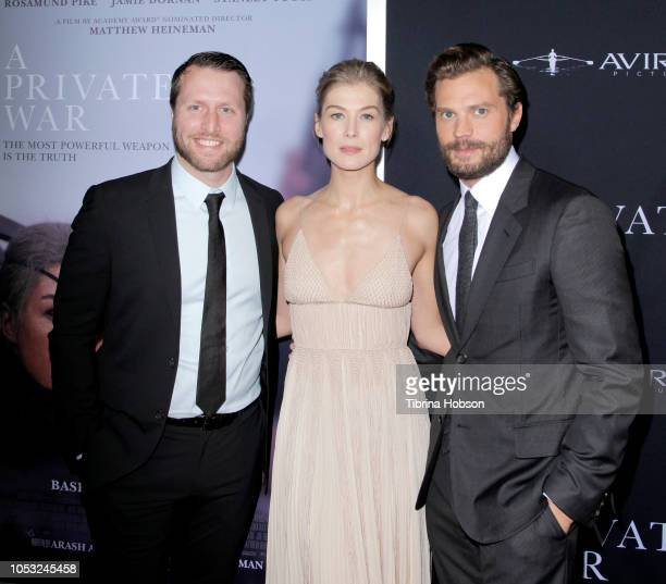 R Matthew Heineman Rosamund Pike and Jamie Dornan attend the Los Angeles premiere of 'A Private War' at Samuel Goldwyn Theater on October 24 2018 in...