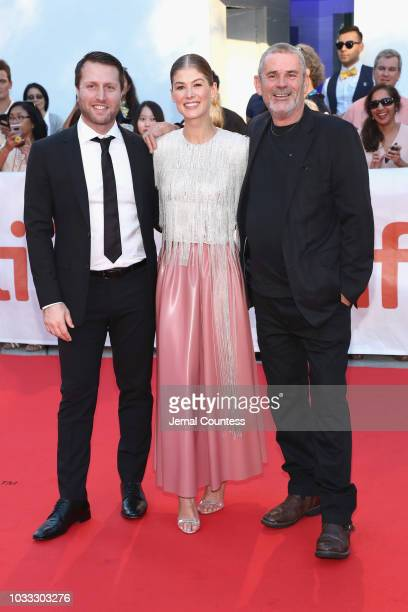 Matthew Heineman Rosamund Pike and Paul Conroy attend the A Private War premiere during 2018 Toronto International Film Festival at Roy Thomson Hall...
