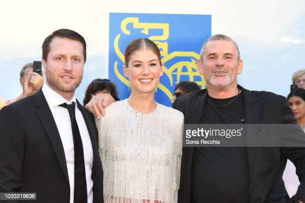 Matthew Heineman Rosamund Pike and Paul Conroy attend the 'A Private War' premiere during 2018 Toronto International Film Festival at Roy Thomson...