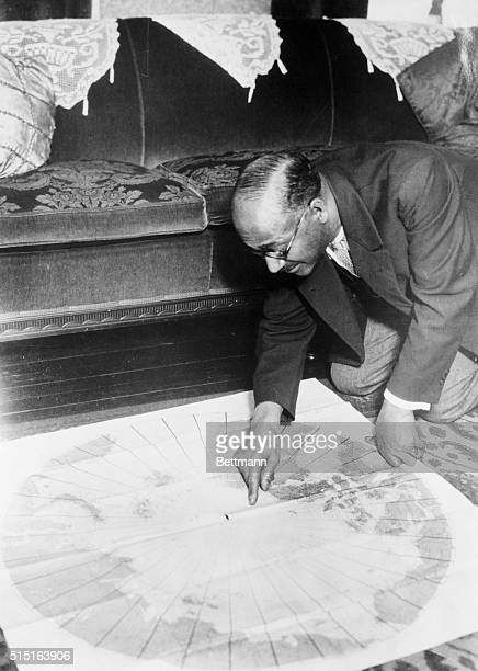Matthew Henson Pointing at Map