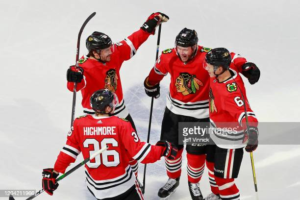 Matthew Highmore of the Chicago Blackhawks is congratulated by his teammates after scoring a goal against the Edmonton Oilers during the third period...