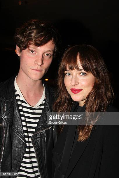 Matthew Hitt and Dakota Johnson pose at The Opening Night of The Last Ship on Broadway at The Neil Simon Theatre on October 26 2014 in New York City
