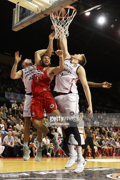 Matthew Hodgson of the 36ers and Mitchell Norton of the Hawks compete for a rebound during the round 18 NBL match between the Illawarra Hawks and the...
