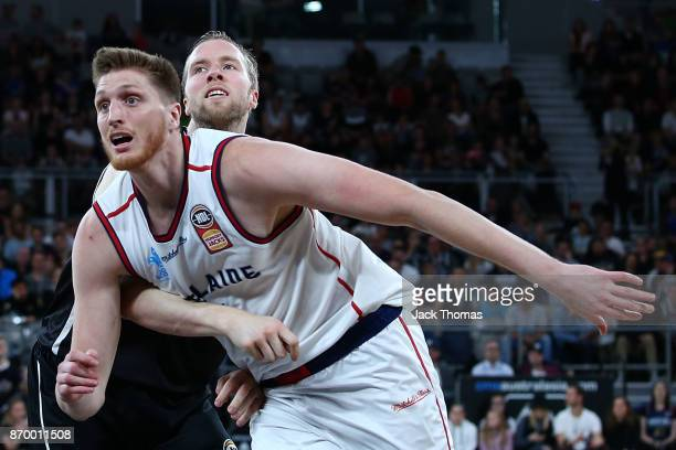 Matthew Hodgson of the Adelaide 36ers and David Barlow of of Melbourne United compete for a rebound during the round five NBL match between Melbourne...