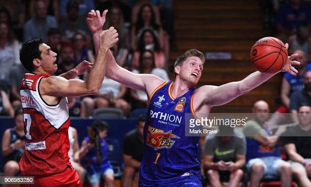 Matthew Hodgson of the Adelaide 36ers and Oscar Forman of the Illawarra Hawks during the round 15 NBL match between the Adelaide 36ers and the...