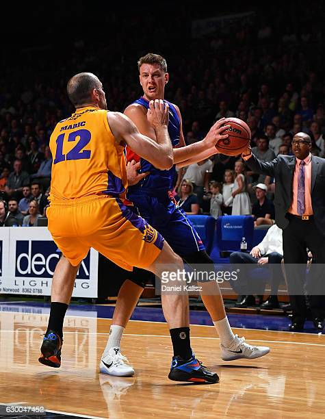 Matthew Hodgson of the Adelaide 36ers attempts to shoot over Aleks Maric of the Sydney Kings during the round 11 NBL match between Adelaide 36ers and...