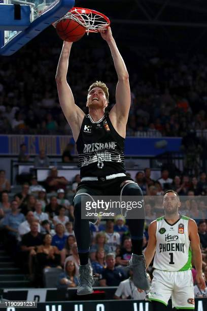 Matthew Hodgson of the Bullets dunks the ball during the round nine NBL match between the Brisbane Bullets and the South East Melbourne Phoenix at...
