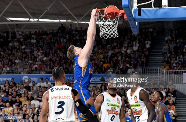 Matthew Hodgson of the Bullets slam dunks during the round 20 NBL match between the Brisbane Bullets and the Cairns Taipans at Nissan Arena on...
