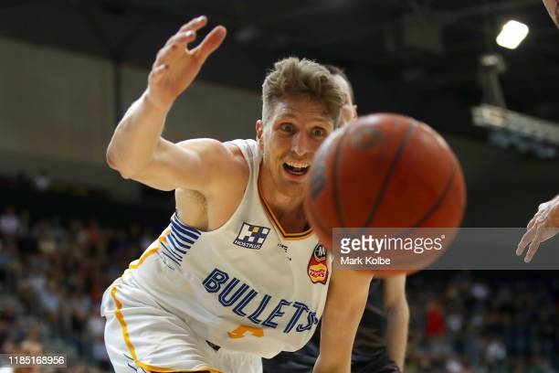 Matthew Hodgson of the Bullets stretches for the ball during the round five NBL match between the Illawarra Hawks and the Brisbane Bullets at AIS...