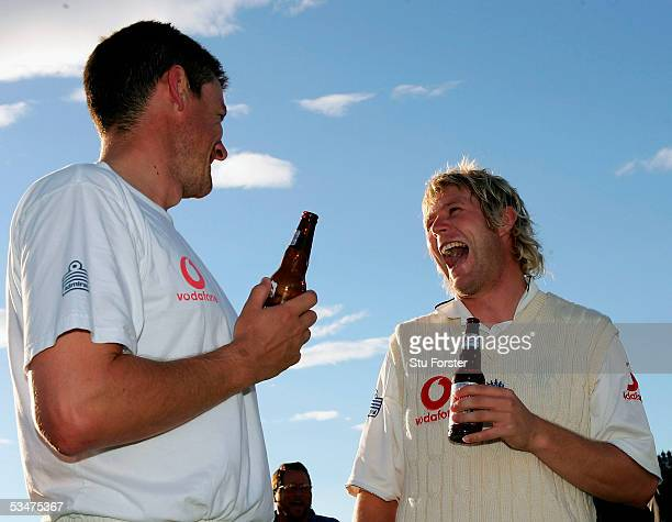 Matthew Hoggard and Ashley Giles of England celebrate victory during day four of the Fourth npower Ashes Test match between England and Australia at...