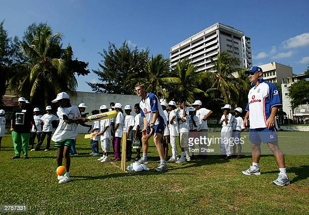 Matthew Hoggard and Graham Thorpe of England play cricket with some kids during the VSO Peace cup Six a Side tournament at the Air Force Cricket...