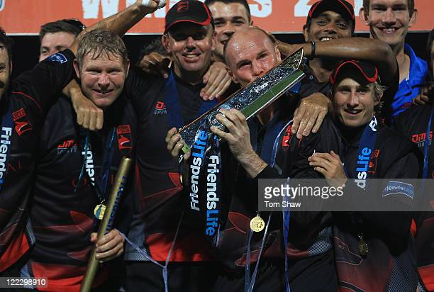 Matthew Hoggard and Paul Nixon of Leicestershire celebrate with the trophy during the Friends Life T20 Final match between Leicestershire and...