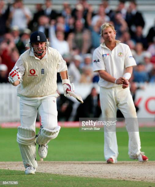 Matthew Hoggard of England celebrates as the winning runs are scored with Shane Warne of Australia looking on during day four of the Fourth npower...
